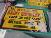 NOS McCormick Deering Dairy Equipment Painted Tin Sign