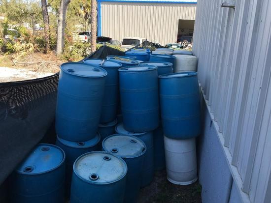 Lot of water barrels (at front of building)