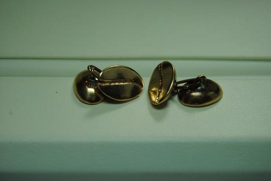 Gold cuff links.