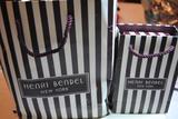 Two bags of Henri Bendel jewelry.