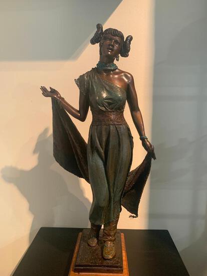 """She Walks Like a Lady"" bronze sculpture"
