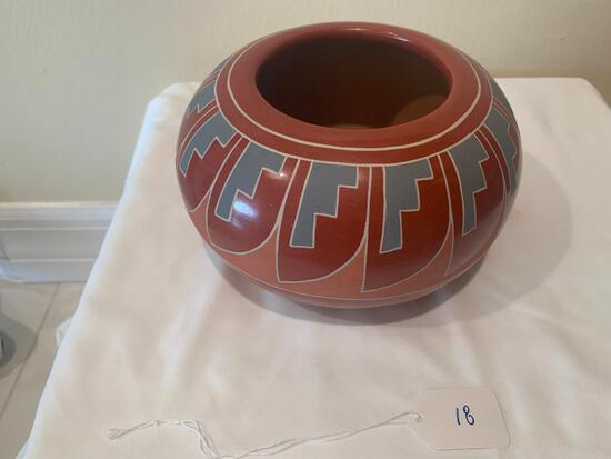 Redware Pot with stair step incised pattern around the rim with cream slip