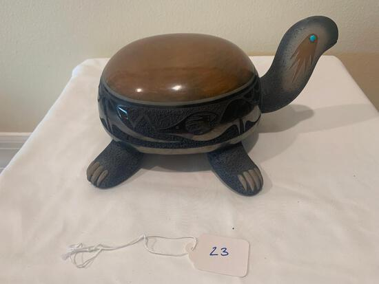 Black and sienna ceramic turtle with ?avanyu? motif and one turquoise eye