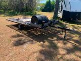 10'x 6' flat bed single axle trailer w/ ramps