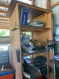 Wooden shelf and contents: fan, lights, wrenches, air can