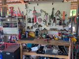 Workbench with contents: metal shelves, misc. tools, parts, clamps, file cabinet