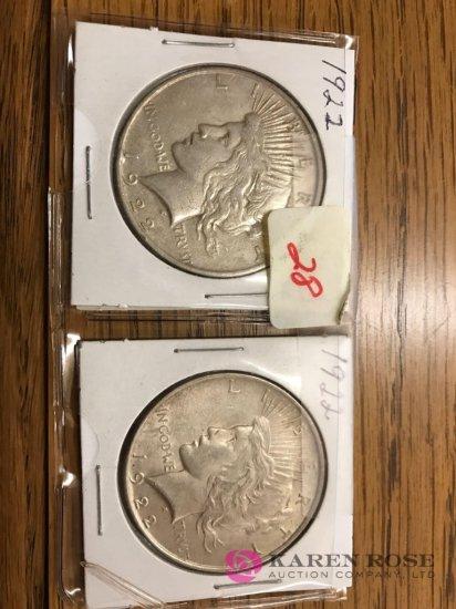 2 coins 1922 peace dollars