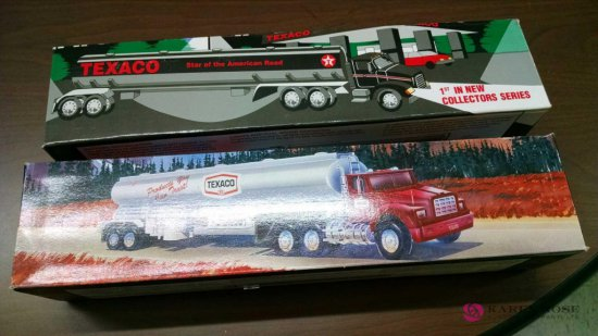 Two Texaco toy tanker trucks