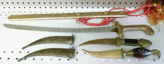 Three knives with sheaths