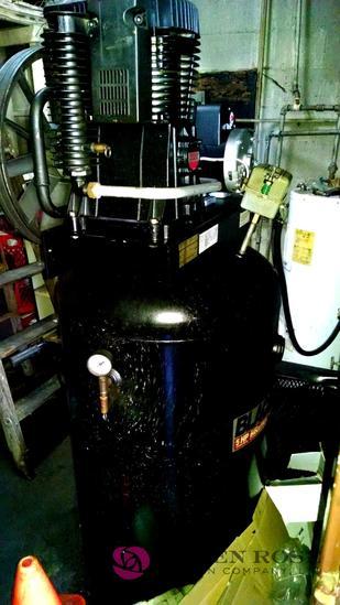 Black 5 horsepower industrial air compressor
