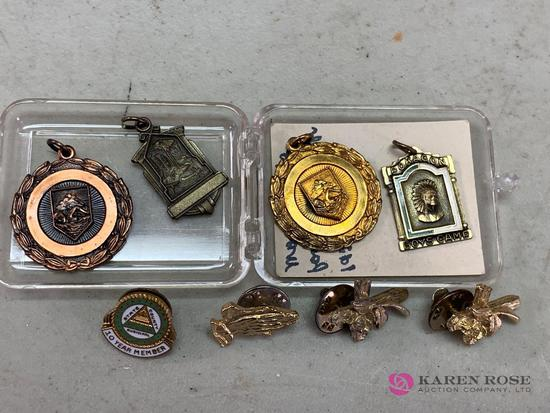 Assorted charms and awards