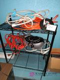 rack with 4 extension cords radio and Tatum measure