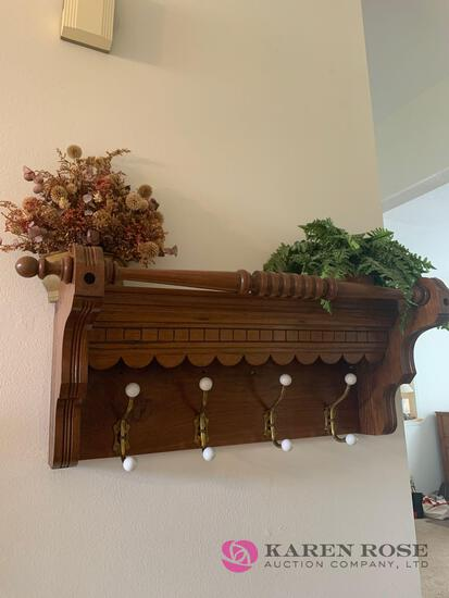 Wooden coat rack and artificial flowers
