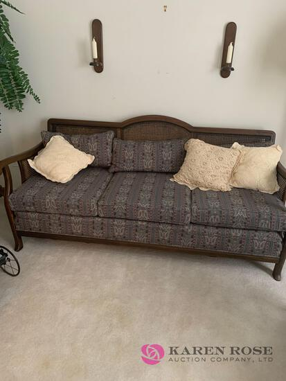 Cane back sofa with cushions