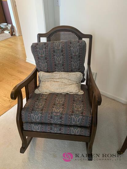 Cane back rocking chair with cushions