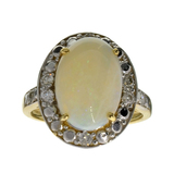 APP: 3.1k 14 kt. Yellow/White Gold, 3.10CT Opal And Diamond Ring