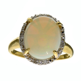 APP: 2.6k 14KT. Yellow/White Gold, 2.71CT Opal And Diamond Ring