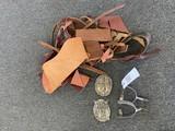 Spurs, Belt buckles, bundle of leather pieces