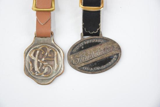 2- Studebaker Metal Watch Fobs