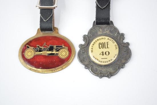 2- Cole Automobile Enamel and Celuloid Watch Fobs