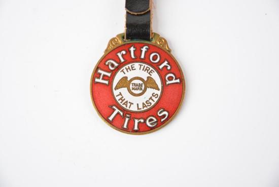 "Hartford Tires ""The Tires That Lasts"" enamel metal watch fob"