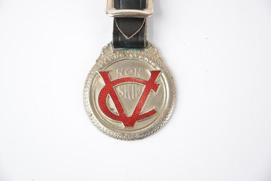 Pennsylvania Vacuum Cup Non-Skid Tire enamel metal watch fob