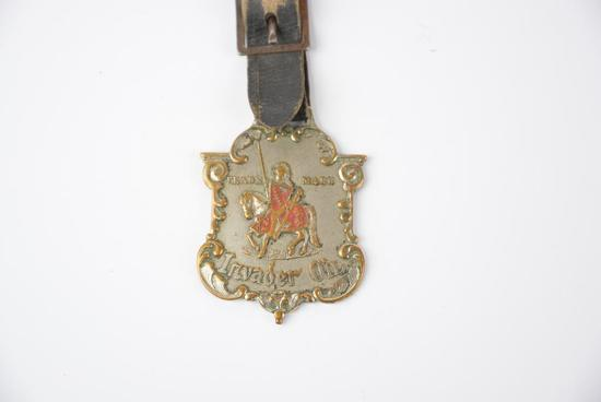 Invader Oil w/Knight on horse back trade mark enamel metal watch fob