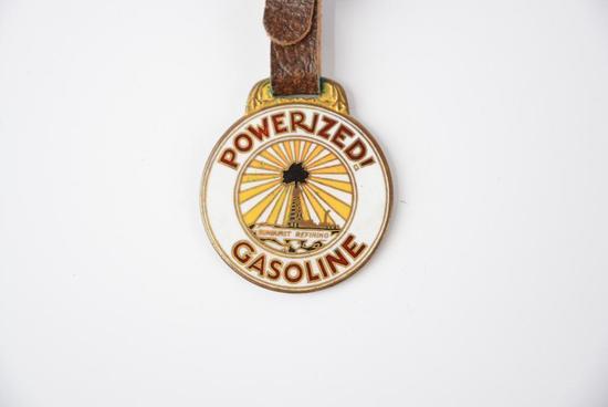 Powerized! Gasoline Sunbrust Refining Enamel Watch Fob