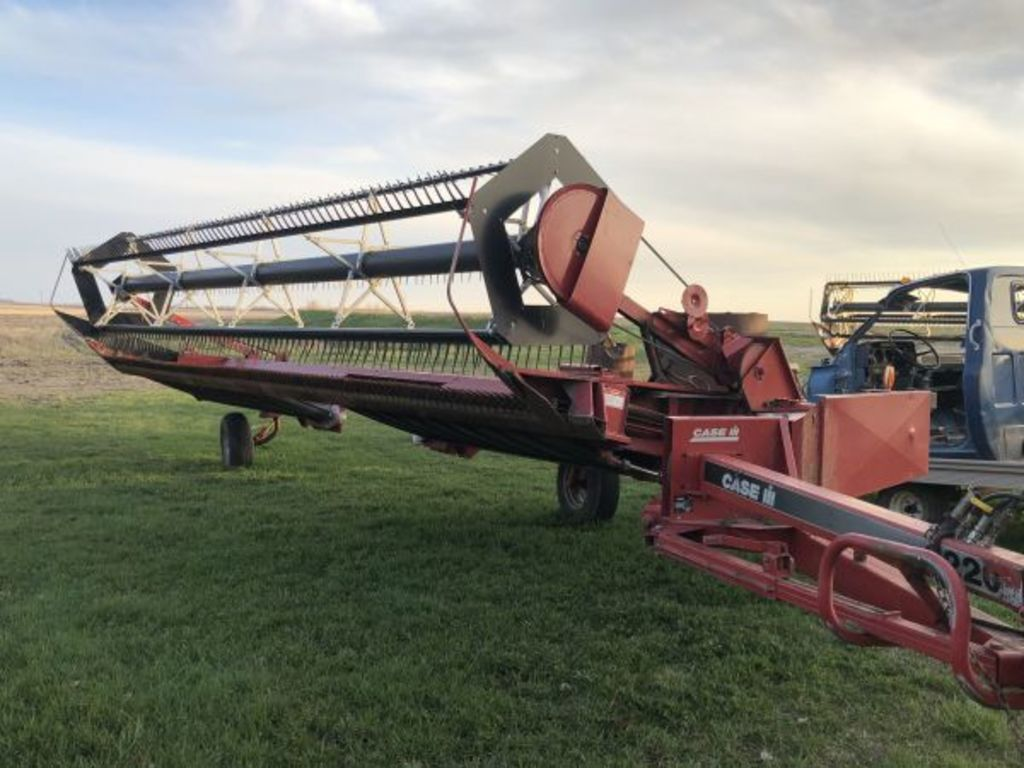 Case IH Model 8220 pull type swather w/ finger reel