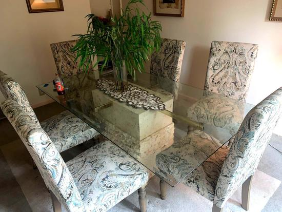 Large glass table six chairs