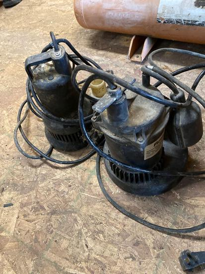 Small lot of two sump pumps, three small tires and wheels