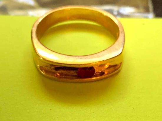 14k ring ,w/red stone
