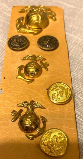 Lot of seven military pins and buttons