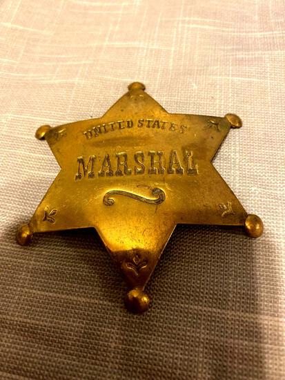 Brass or copper United States Marshal badge