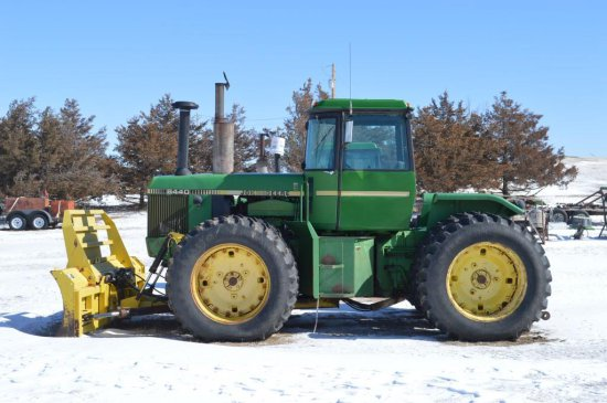 JD 8440 4WD Tractor and Degelman Dozer tied together