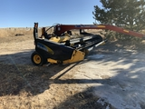 2009 New Holland 7150 Hydro-Swing Swather
