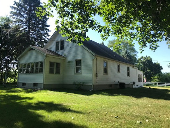North Liberty Home and 20+ Acres ~ No Resesrve!