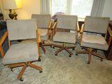 4 Oak Swivel Chairs