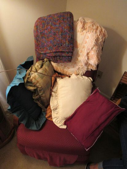 Chair, pillows, and afghans