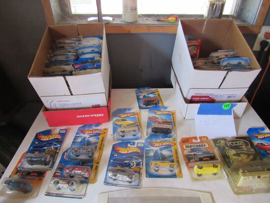 2 boxes of various hot wheels