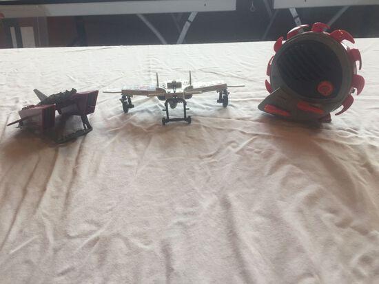 Three G.I. Joe Cobra toys, Claw,  Jetpack, and  Buzz Boar