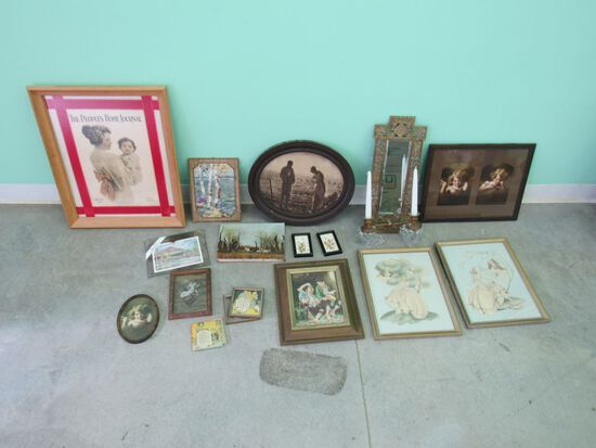 Grouping of different sizes and shapes of framed pictures