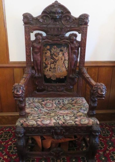 Highly carved ornate Gothic side chair with figural carvings