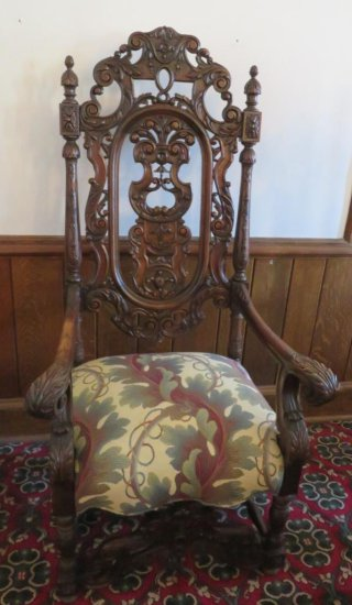 William and Mary style heavily carved side chair with a botanical upholstery seat