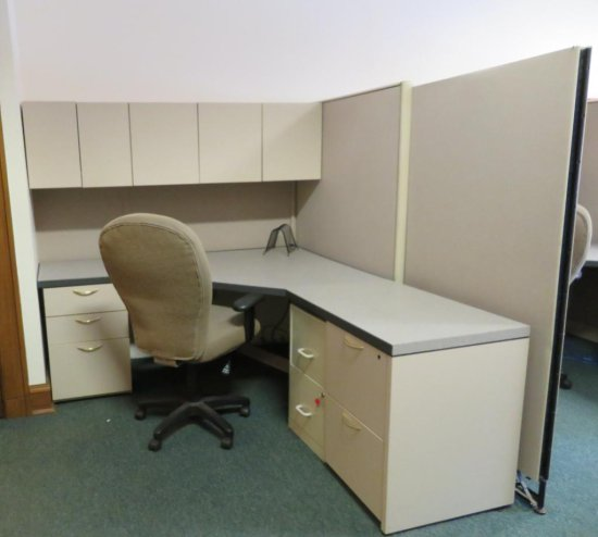 Office cubicle with files, chair, and upper cabinets and extra privacy wall