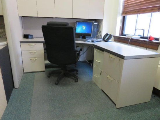Office cubicle with upper cabinets and files