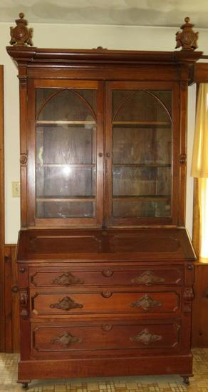 "7' 6"" two piece Walnut carved secretary"