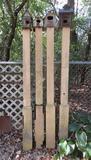 Five wooden birdhouses on posts, garden art