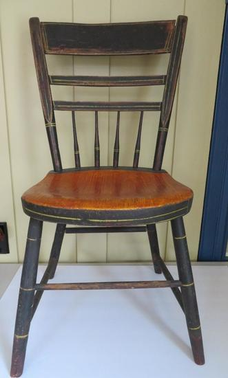 Early primitive solid seat chair