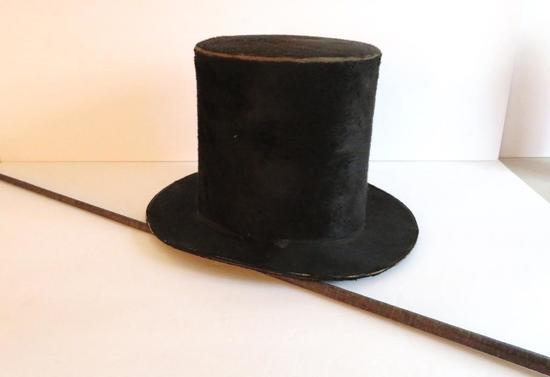 Antique Stove Pipe hat and leather wrapped walking stick